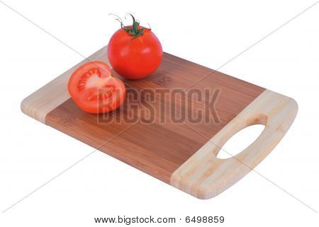 Cutting board with tomatoes