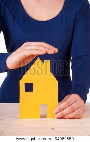 Hands Protecting A House