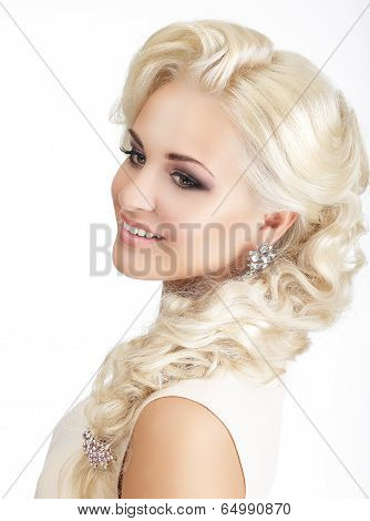 Portrait Of Delighted Smiling Blonde With Tress And Jewelry