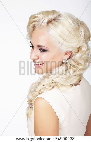 Portrait Of Smiling Fashionable Blond Hair Woman With Plait