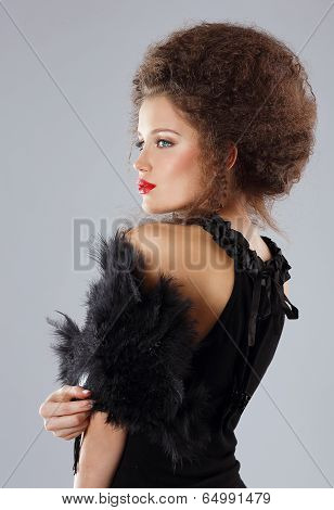 Fashionable Glamorous Brunette With Frizzy Hairs In Evening Dress