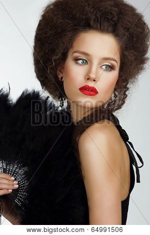 Character. Refined Exquisite Brunette Holding Fan With Feather