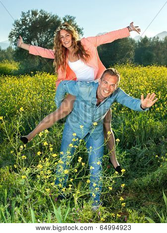 Happy Lively Young Couple Riding Piggy Back
