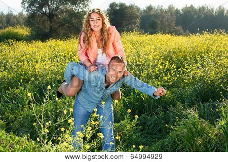 Playful Young Couple Riding Piggy Back