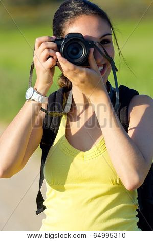 Happy Young Girl Taking Photos In The Field