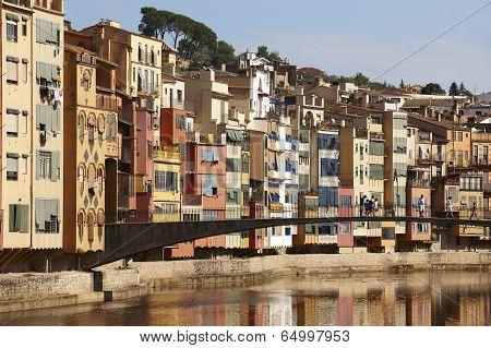 Spain. Catalonia. Girona. Oñar Colorful Houses And Bridge.