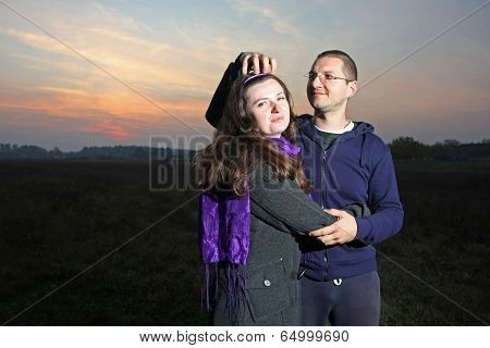 Couple Is Goofing Around At Sunset