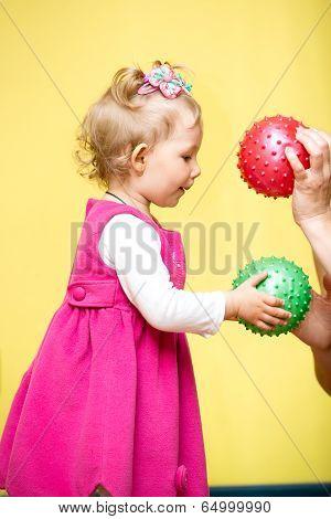 Little Child Girl Playing With Ball In Kindergarten In Montessori Preschool Class.