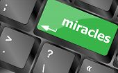 stock photo of qwerty  - Computer keyboard key button with miracles text - JPG