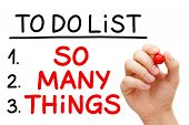 picture of overwhelming  - Hand writing So Many Things in To Do List with red marker isolated on white - JPG