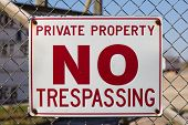 stock photo of no entry  - A sign warning that the area is private property and no trespassing allowed