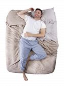 picture of deprivation  - top view of sleep deprived man on a bed - JPG