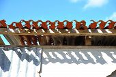picture of derelict  - Detail of derelict building with broken wall panels and rusted out iron roof - JPG