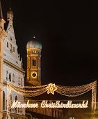 picture of tree lined street  - The Munich markets are breathtakingly beautiful with fairy lights lining the streets and illuminated Christmas trees and stars dotted around the marketplace - JPG