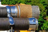 stock photo of suction  - Large suction strainer on a old fire engine - JPG