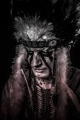 stock photo of indian chief  - American Indian chief with big feather headdress - JPG