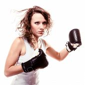 picture of martial arts girl  - Martial arts. Sport boxer woman in black gloves. Fitness girl training kick boxing isolated on white. Studio shot.