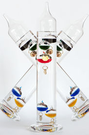picture of galileo-thermometer  - Three water Galileo thermometers with colorful globes in liquid - JPG