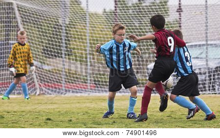 A Trio Of Youth Soccer Players Compete