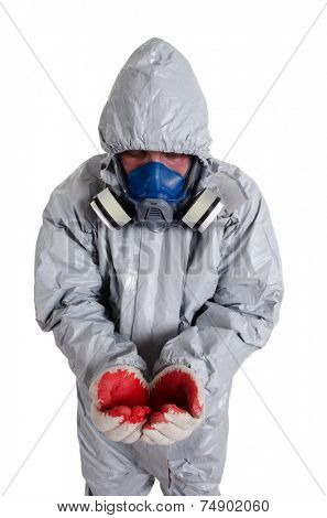 A pest control worker wearing a mask, hood, protective suit.