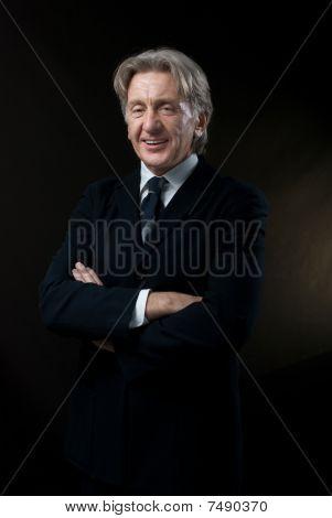 Smiling Gentleman On Dark Background