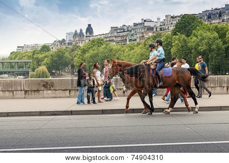 Mounted Police Riding Past The Bystanders On The Bridge In Paris