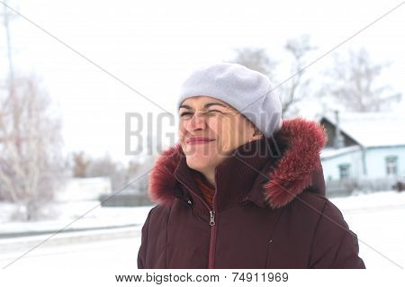 Woman In Her 40 S In Winter Winking