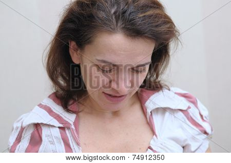 Woman In Her 40 S Looking Down