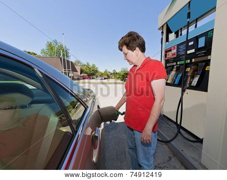 Middle-aged Woman Pumping Gasoline