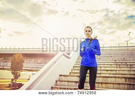 Female runner running down the stairs