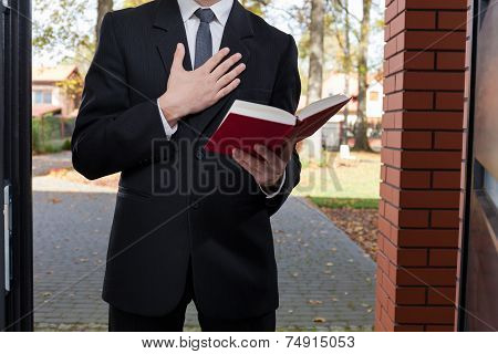 Jehovah's Witness Standing At The Door