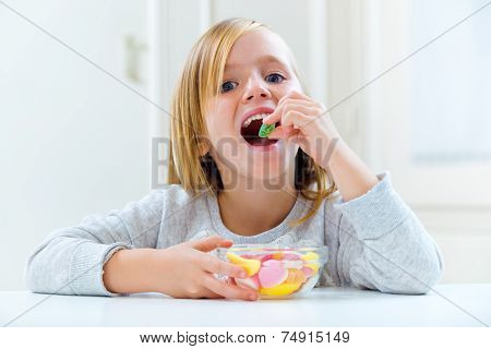 Beautiful Child Eating Sweets At Home.