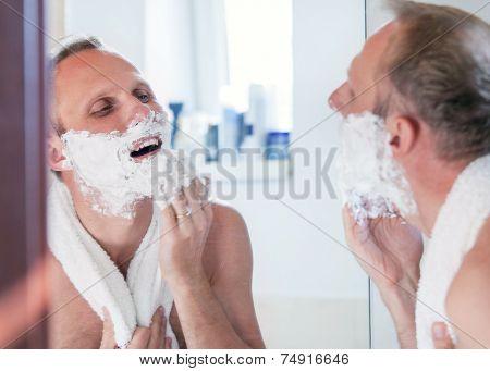 Shaving Man Near The Mirror
