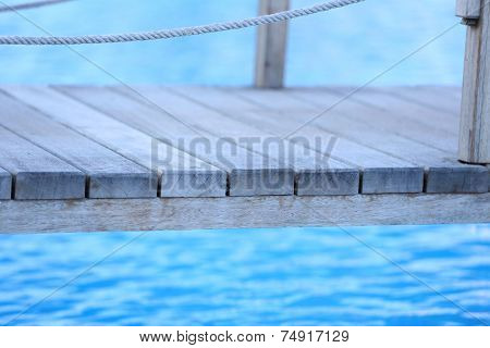 Wooden bridge on way to harbor, close-up