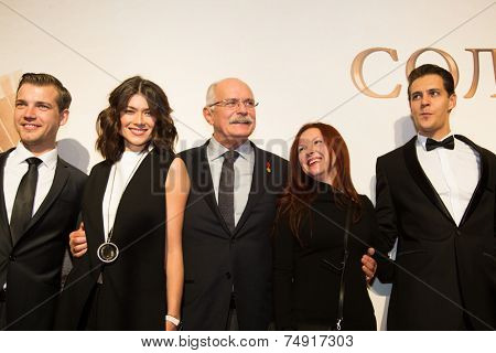 MOSCOW - OCTOBER, 7: M. Kalita, M. Solovyeva, N.Mikhalkov. Premiere of the movie Solnechny Udar, October, 7, 2014 at Octyabr Cinema in Moscow, Russia