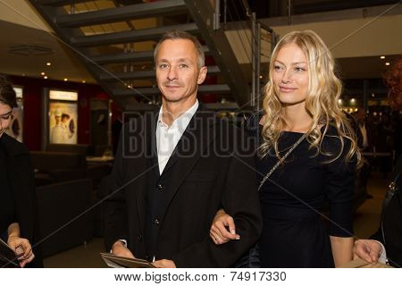 MOSCOW - OCTOBER,7 : Stepan Mikhalkov with wife. Premiere of the movie Solnechny Udar, October,7, 2014 at Octyabr Cinema in Moscow, Russia