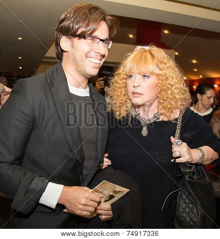 MOSCOW - OCTOBER,7 : Singer Alla Pugacheva and M. Galkin. Premiere of the movie Solnechny Udar, October, 7, 2014 at Octyabr Cinema in Moscow, Russia