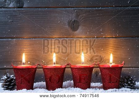 Wooden background with Christmas candles