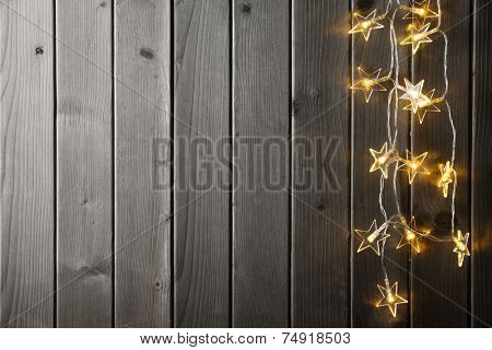 Christmas light on wood background