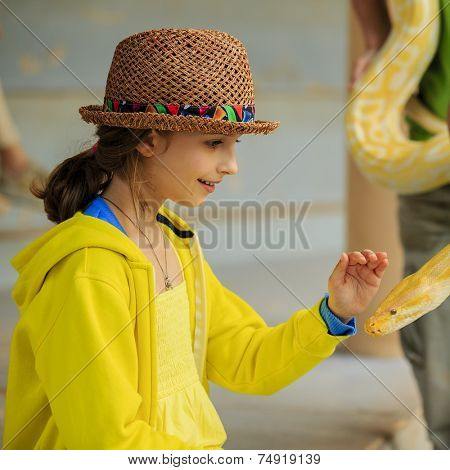 Trip to the Zoo - girl and snake at the Zoo
