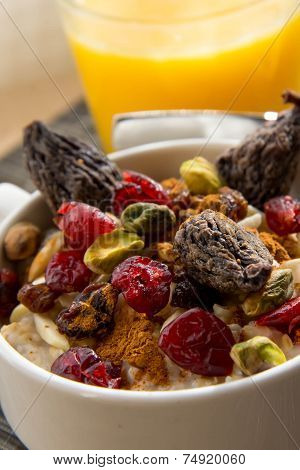 Healthy Breakfast Oatmeal With Dried  Fruit And Nut Toppings