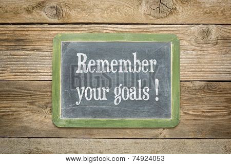 remember your goals reminder on a  slate blackboard against rustic weathered wood planks