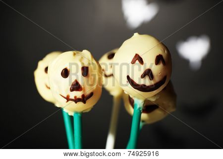 Funny Halloween cake pops on dark background
