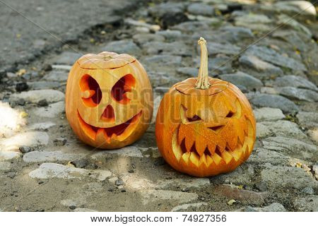 Pumpkins for holiday Halloween on paved road