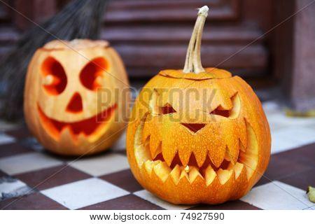 Pumpkins and broom for holiday Halloween