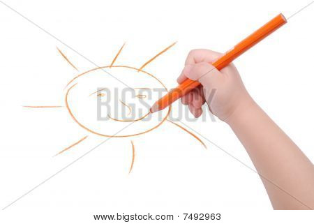 Childrens Hand With Pencil Draws The Sun
