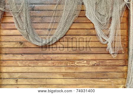 Hanging Fishnet On Wood Wall