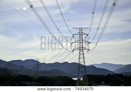 Pylons Of The High Voltage Electric Cables In The Mountain