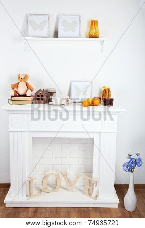 Fireplace with beautiful decorations in comfortable living room