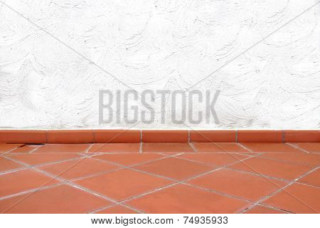 Terracotta Tailed Floor And White Concrete Wall